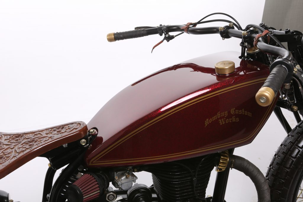 Barood - 2015 Royal Enfield Rider Mania Custom Bike Winner - red tank with pinstripping